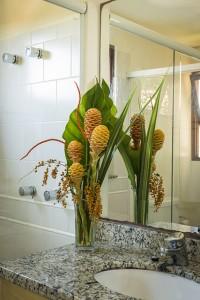 Pousada das Palmeiras Lagoa da Conceicao Florianopolis Suite ar banheiro arranjo
